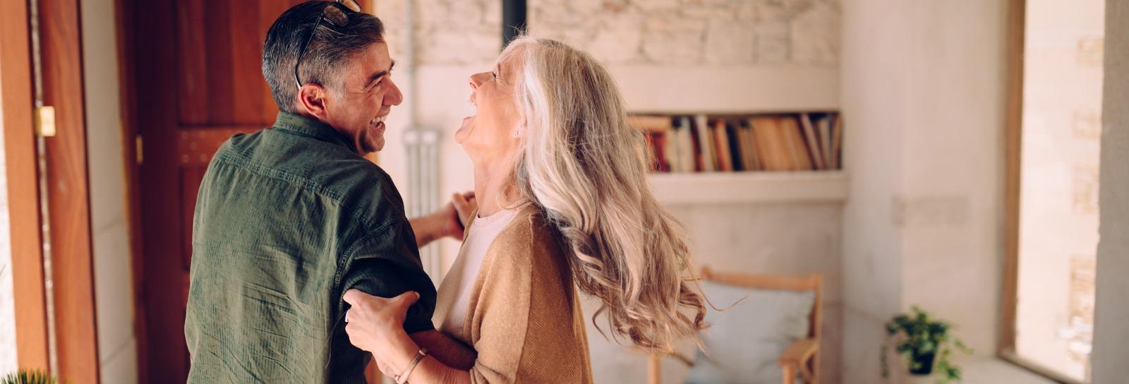 Senior couple dancing merrily